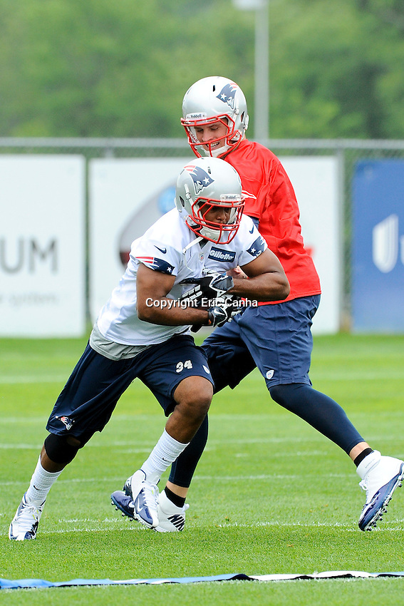 New England Patriots quarterback Ryan Mallett (15) hands off the ball to running back Shane Vereen (34) during the New England Patriots Organized Team Activities held at Gillette Stadium in Foxborough Massachusetts.  Eric Canha/CSM