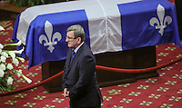 Quebec City mayor Regis Labeaume gives his condolences to Lisette Lapointe, wife of former Quebec premier Jacques Parizeau, as her husband lies in state at the National Assembly in Quebec City on Sunday June 7, 2015.
