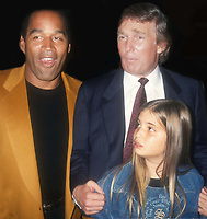 OJ Simpson Donald Trump and Ivanka Trump 1993<br /> Opening of Harley Davidson Cafe<br /> Photo By John Barrett/PHOTOlink