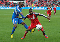 20 October 2012: Montreal Impact midfielder Sanna Nyassi #11 and Toronto FC defender Ashtone Morgan #5 in action during an MLS game between the Montreal Impact and Toronto FC at BMO Field in Toronto, Ontario Canada. .The ended in a 0-0 draw..