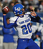 Sam Brown #20, Long Beach quarterback, throws a pass during the Nassau County varsity football Conference II semifinals against Garden City at Hofstra University on Saturday, Nov. 12, 2016. Garden City won by a score of 36-8.