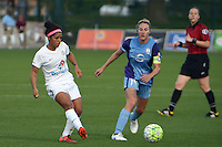 Kansas City, MO - Saturday May 28, 2016: FC Kansas City midfielder Desiree Scott (3) kicks as Orlando Pride midfielder Becky Edwards (14) defends. FC Kansas City defeated Orlando Pride 2-0 during a regular season National Women's Soccer League (NWSL) match at Swope Soccer Village.