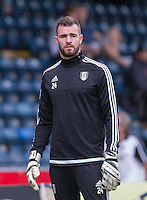 Goalkeeper Andy Lonergan of Fulham warms up pre match during the Capital One Cup match between Wycombe Wanderers and Fulham at Adams Park, High Wycombe, England on 11 August 2015. Photo by Andy Rowland.
