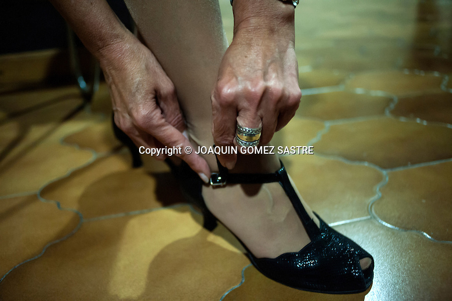 A woman puts high heeled shoes for dancing tango<br />  PHOTO &copy; JOAQUIN GOMEZ  SASTRE