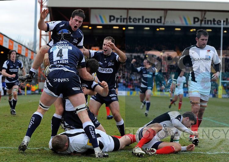 Chris Bell of Sale Sharks is mobbed after scoring a try