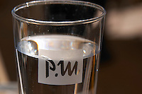 Glass of water marked PM. Restaurant PM and Friends (PM och Vanner) Vaxjo town. Smaland region. Sweden, Europe.