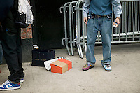 A man tries on a new pair of sneakers after attending Dunkxchange, a market held in a club in New York City, USA, where sneaker collectors trade and sell their rare shoes, 7 January 2007.<br />