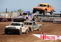 Apr 17, 2011; Surprise, AZ USA; LOORRS driver Carl Renezeder (17) leads Rick Huseman (36), Ricky Johnson (48) and Adrian Cenni (11) during round 4 at Speedworld Off Road Park. Mandatory Credit: Mark J. Rebilas-