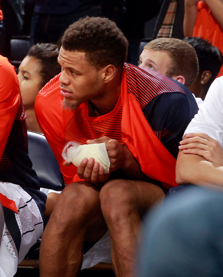 Virginia guard Justin Anderson (1) holds his injured hand during the game Saturday Feb. 7, 2015, in Charlottesville, Va. Virginia defeated Louisville  52-47. (Photo/Andrew Shurtleff)