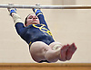 Gillian Murphy of Massapequa performs on the uneven bars during a Nassau County varsity gymnastics meet against South Side at McKenna Elementary School in Massapequa Park on Monday, Jan. 29, 2018. She scored an 8.7 in the event and won the all-around with a 35.8 to lead Massapequa to a 167.2-155.45 victory.