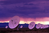 VLA (Very Large Array) Radio Telescope, New Mexico......VLA radio telescope array New Mexico space tracking technology desert contact search alien life sunset pink purple yellow mountains clouds
