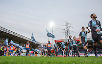 The players head onto the pitch during the Sky Bet League 2 match between Wycombe Wanderers and Crawley Town at Adams Park, High Wycombe, England on 28 December 2015. Photo by Andy Rowland / PRiME Media Images