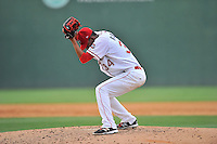 Starting pitcher Roniel Raudes (34) of the Greenville Drive winds up before delivering a pitch in a game against the Lakewood BlueClaws on Sunday, June 26, 2016, at Fluor Field at the West End in Greenville, South Carolina. Greenville won, 2-1. (Tom Priddy/Four Seam Images)