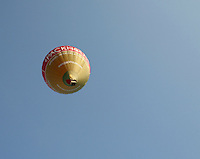 Balloons rise into the sky lifted by hot air from propane burners, British School of ballooning, Ebernoe, West Sussex.