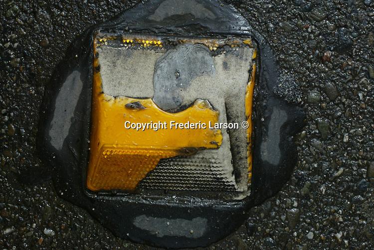 Street reflector on California Street after a rain in San Francisco, California. .