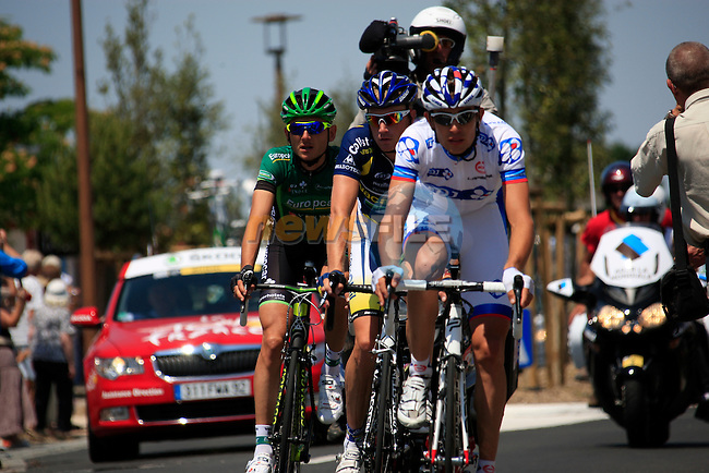 The breakaway group featuring Jeremy Roy (FRA) FDJ, Lieuwe Westra (NED) Vacansoleil-DCM and Perrig Quemeneur (FRA) Team Europcar pass through Bretignolles sur Mer during the 1st stage form Passage du Gois to Mont des Alouettes of the 2011 Tour de France, 2nd July 2011 (Photo by Eoin Clarke/NEWSFILE)