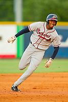 Carlos Franco (11) of the Danville Braves hustles towards third base against the Burlington Royals at Burlington Athletic Park on July 19, 2012 in Burlington, North Carolina.  The Royals defeated the Braves 4-3.  (Brian Westerholt/Four Seam Images)