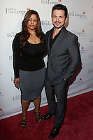HOLLYWOOD, LOS ANGELES, CA, USA - OCTOBER 09: Elsie Rodriguez, Freddy Rodriguez arrive at the Eva Longoria Foundation Dinner held at Beso Restaurant on October 9, 2014 in Hollywood, Los Angeles, California, United States. (Photo by David Acosta/Celebrity Monitor)