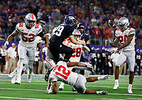 Ohio State Buckeyes safety Isaiah Pryor (12) pressures TCU Horned Frogs punter Adam Nunez (29) after he bobbled a punt during the third quarter of a NCAA Division I college football game between the TCU Horned Frogs and the Ohio State Buckeyes on Saturday, September 15, 2018 at AT&T Stadium in Arlington, Texas. [Joshua A. Bickel/Dispatch]