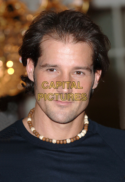 "JOSEF BROWN .Photocall to promote the Charity Gala performance of ""Dirty Dancing"" in aid of Refuge - at the Aldwych Theatre, London, England. .January 9th 2008.headshot portrait beads beaded necklace  .CAP/BEL.©Tom Belcher/Capital Pictures"