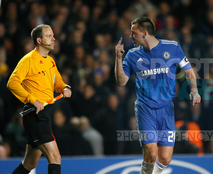 Chelsea's John Terry has words with the linesman