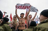 Mehrere hundert Menschen protestierten am Samstag den 16. Februar 2013 in Berlin Neukoelln gegen eine Veranstaltung der NPD. Die NPD hatte zu einer oeffentlichen Diskussionsveranstaltung gegen ein geplantes Fluechtlingsheim mobilisiert.<br />Im Bild: Frauen der feministischen Gruppe Femen protestierten mit nacktem Oberkoerper, Plakaten und antifaschistischen Parolen auf den Bruesten gegen die Neonazis. Alle Femen-Frauen wurden von der Polizei festgenommen.<br />16.2.2013, Berlin<br />Copyright: Christian-Ditsch.de<br />[Inhaltsveraendernde Manipulation des Fotos nur nach ausdruecklicher Genehmigung des Fotografen. Vereinbarungen ueber Abtretung von Persoenlichkeitsrechten/Model Release der abgebildeten Person/Personen liegen nicht vor. NO MODEL RELEASE! Don't publish without copyright Christian-Ditsch.de, Veroeffentlichung nur mit Fotografennennung, sowie gegen Honorar, MwSt. und Beleg. Konto:, I N G - D i B a, IBAN DE58500105175400192269, BIC INGDDEFFXXX, Kontakt: post@christian-ditsch.de<br />Urhebervermerk wird gemaess Paragraph 13 UHG verlangt.]