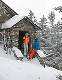 Vermont, Stowe Resort, Seth Morse and Kristie Brown Lovell in front of the Stone Hut, at top of Nosedive Run.