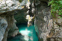 Bovec, Julian Alps, Slovenia, July 2011. The Soca river cuts deep gorges and canyons through the soft rock, creating a paradise for canyoning,kayaking and rafting, or just swimming. Slovenia boasts a very spectacular carstic landscape with high limestone rock formations oozing with waterfalls, and fast flowing cristal clear waters that run through the Soca from the Triglav National Park to the Adriatic Sea. Photo by Frits Meyst/Adventure4ever.com