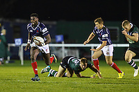 Matt Williams of London Scottish evades the challenge from Heath Stevens of Nottingham Rugby during the Greene King IPA Championship match between London Scottish Football Club and Nottingham Rugby at Richmond Athletic Ground, Richmond, United Kingdom on 16 October 2015. Photo by David Horn.