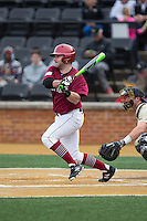 DJ Link (13) of the Harvard Crimson follows through on his swing against the Wake Forest Demon Deacons at David F. Couch Ballpark on March 5, 2016 in Winston-Salem, North Carolina.  The Crimson defeated the Demon Deacons 6-3.  (Brian Westerholt/Four Seam Images)