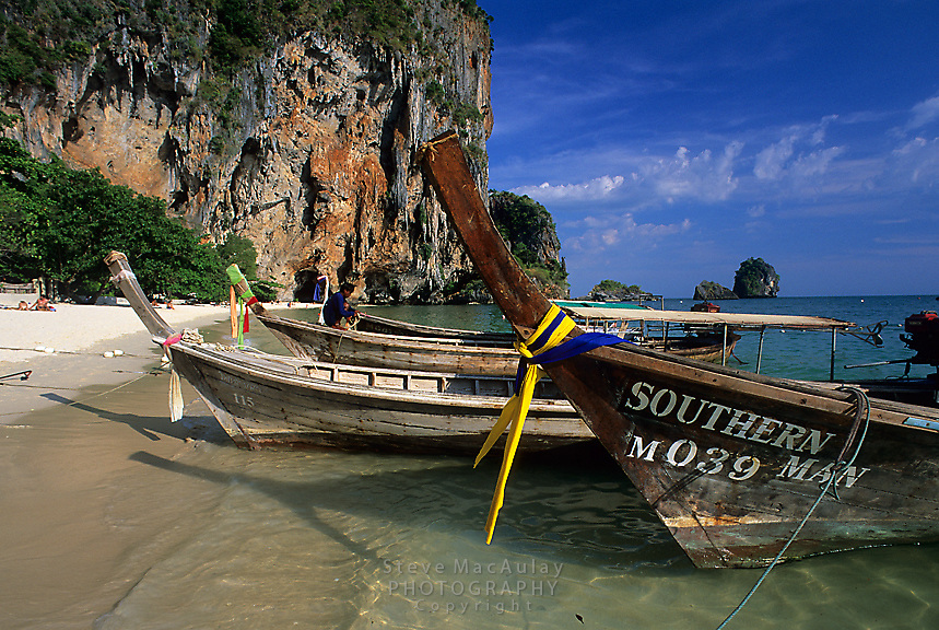 Longtail boats pulled up onshore at Phra Nang Beach,Railay Rei Lei, Thailand
