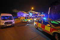 Pictured: Emergency services in the Waunceirch area of Neath, Wales, UK. Monday 14 January 2018<br /> Re: Four flats have been evacuated after an explosion in Neath at 8:30pm on Monday.<br /> Extensive damage was caused to Waun Las, in the Waunceirch area and arrangements made to house its residents until the building is deemed safe.<br /> One woman was taken to hospital with serious burn injuries which are not believed to be life threatening.<br /> A joint investigation is under way between South Wales Police and the fire service to determine the cause.<br /> Wales and West Utilities said the gas supply to the affected property had been isolated.