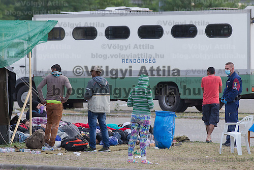 Illegal migrants are under police custody in a refugee camp near border town Roszke (about 180 km South-East of capital city Budapest), Hungary on July 16, 2015. ATTILA VOLGYI
