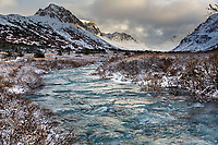 Winter landscape of South Fork of Campbell creek with frozen portions with Chugach Mountains in Chugach State Park. Glenn Alps area of Anchorage, Alaska   <br /> <br /> Photo by Jeff Schultz/SchultzPhoto.com  (C) 2016  ALL RIGHTS RESVERVED