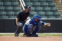 Lexington Legends catcher Freddy Fermin (4) frames a pitch as home plate umpire Jose Lozada looks on during the game against the Kannapolis Intimidators at Kannapolis Intimidators Stadium on May 15, 2019 in Kannapolis, North Carolina. The Legends defeated the Intimidators 4-2. (Brian Westerholt/Four Seam Images)
