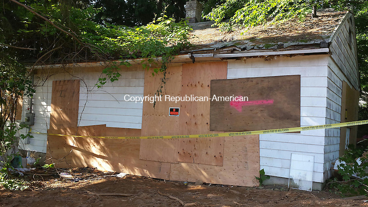 CHESHIRE, CT - June 15, 2014 - 06152014LX02 - A woman who lived in this home on Winslow Street may have died when the floor of her kitchen collapsed.