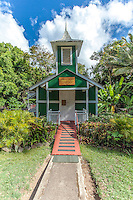 Front view of a little historic green church named Ierusalema Hou Church in Halawa, Moloka'i
