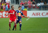 21 August 2010: New York Red Bulls defender Carlos Mendes #44 and Toronto FC forward Mista #10 in action during a game between the New York Red Bulls and Toronto FC at BMO Field in Toronto..The New York Red Bulls won 4-1.