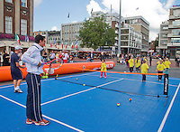 11-sept.-2013,Netherlands, Groningen,  Martini Plaza, Tennis, DavisCup Netherlands-Austria, Draw,   Street tennis on the market squire with Jesse Huta Galung (NED)<br /> Photo: Henk Koster