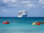 Kids on two water bikes in front of cruise ship, Princess Cays, Eleuthera, Bahamas