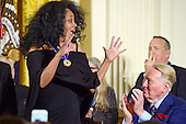 Singer Diana Ross shows her excitement after receiving the Presidential Medal of Freedom from United States President Barack Obama during a ceremony in the East Room of the White House in Washington, DC on Tuesday, November 22, 2016.  Fellow awardee broadcaster Vin Scully applauds at right. The Presidential Medal of Freedom is the Nation's highest civilian honor.<br /> Credit: Ron Sachs / CNP