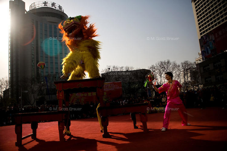 Traditional dog dancers perform for a crowd in downtown Nanjing, China.