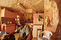 "Miner and tour operator in his ""dugout"" or home. Coober Pedy, South Australia"