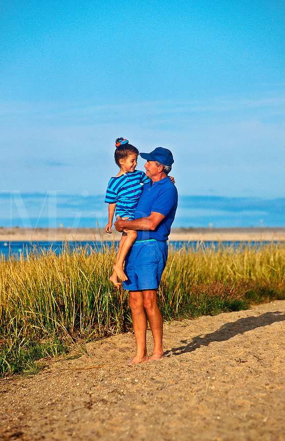 Grandfather and grand daughter walk along the beach, Orleans, Cape Cod
