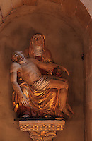Pieta, statue of the Virgin Mary holding the dead body of Christ, in a niche in the transept of the Abbatiale Sainte-Foy de Conques or Abbey-church of Saint-Foy, Conques, Aveyron, Midi-Pyrenees, France, a Romanesque abbey church begun 1050 under abbot Odolric to house the remains of St Foy, a 4th century female martyr. The church is on the pilgrimage route to Santiago da Compostela, and is listed as a historic monument and a UNESCO World Heritage Site. Picture by Manuel Cohen