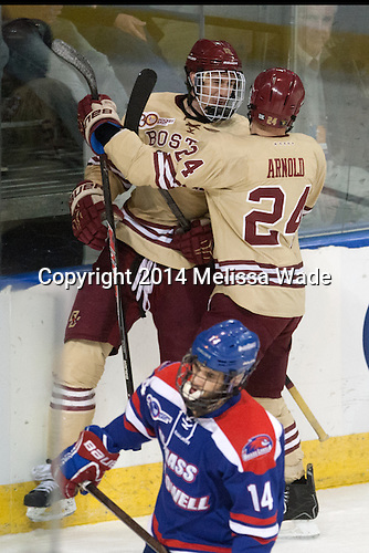 Kevin Hayes (BC - 12), Bill Arnold (BC - 24) - The Boston College Eagles defeated the University of Massachusetts Lowell River Hawks 4-3 in the NCAA Northeast Regional final on Sunday, March 30, 2014, at the DCU Center in Worcester, Massachusetts.