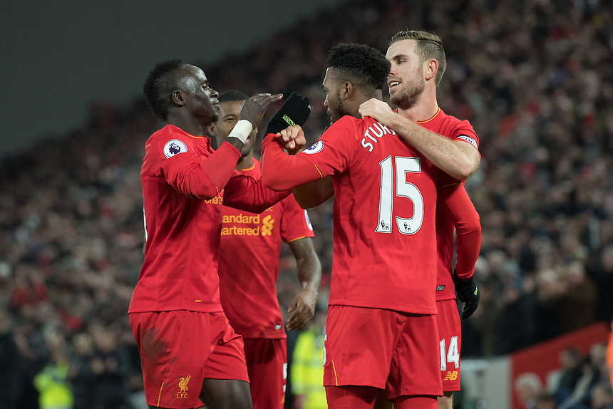 Liverpool's Daniel Sturridge celebrates scoring Liverpools fourth goal with team-mates<br /> <br /> Photographer Terry Donnelly/CameraSport<br /> <br /> The Premier League - Liverpool v Stoke City - Tuesday 27th December 2016 - Anfield - Liverpool<br /> <br /> World Copyright &copy; 2016 CameraSport. All rights reserved. 43 Linden Ave. Countesthorpe. Leicester. England. LE8 5PG - Tel: +44 (0) 116 277 4147 - admin@camerasport.com - www.camerasport.com