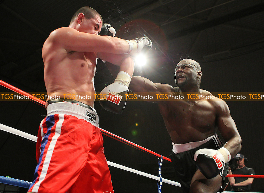 Larry Olubamiwo (back shorts) defeats Yavor Marinchev in a Heavyweight boxing contest at the Harvey Hadden Leisure Centre, Nottingham, promoted by Frank Maloney - 20/11/09 - MANDATORY CREDIT: Gavin Ellis/TGSPHOTO - Self billing applies where appropriate - Tel: 0845 094 6026