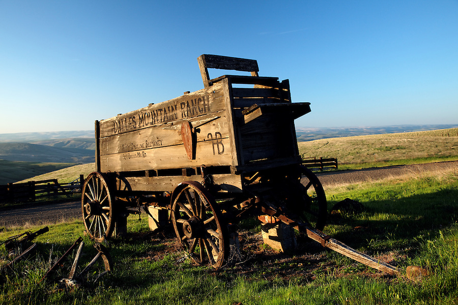 Wood wagon on farm pasture, Columbia Hills State Park, Klickitat County, Washington, USA