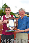 Martin Fitzgerald Kerry AAI chairman presents Padraig Whelan Listowel the Eamon Fitzgerald perpetual trophy for winning the triple jump at the Kerry AAI Championships in Castleisland on Sunday   Copyright Kerry's Eye 2008
